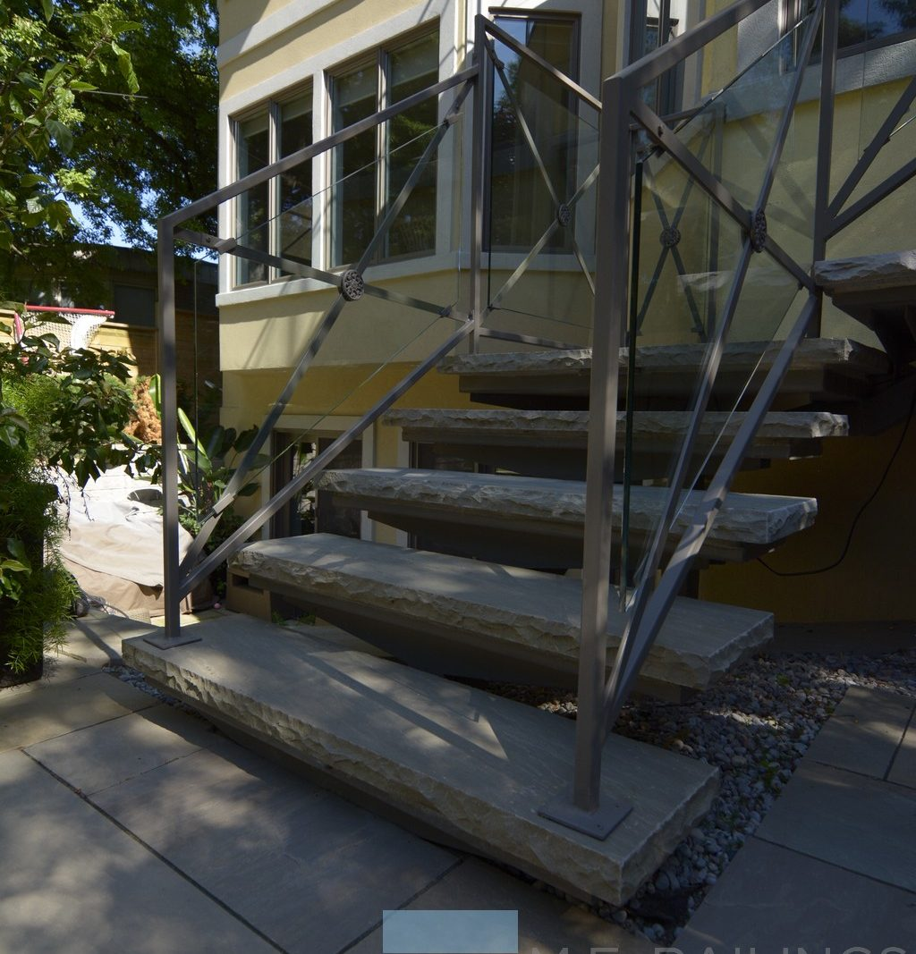 Stainless steel railings with glass and wrought iron steps toronto railings provides exterior for Stainless steel railings interior