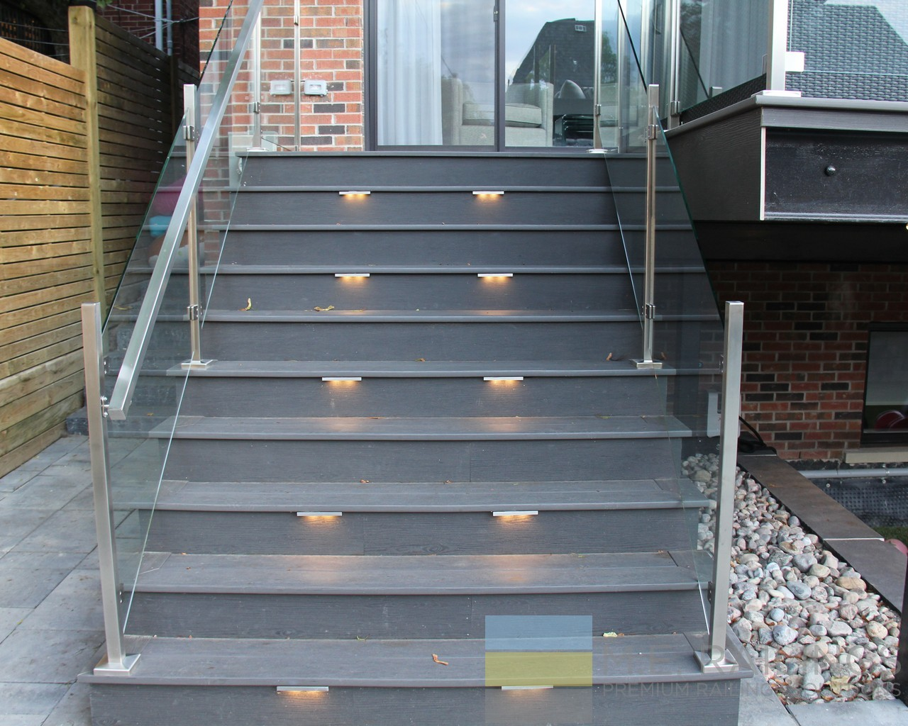 Glass and stainless steel railings for deck pool